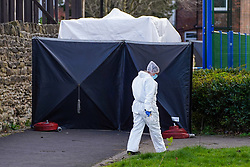 © Licensed to London News Pictures. 11/04/2021. Sheffield, UK.  Forensics officers work at the crime scene near Sheffield United football stadium in Sheffield, following a fatal shooting last night. Police were called to Clough Road near Sheffield United Football Stadium in Sheffield at around 9.40pm on Saturday following reports of shots fired. He was pronounced dead at the scene and a second man, 31, was being treated for minor injuries in hospital, said South Yorkshire Police. Photo credit:  Ioannis Alexopoulos/LNP