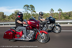 Motorcycle Racer Carey Hart riding a red 2017 Indian Chieftain Elite with Bagger Magazine's Morgan Gales riding a black 2017 Indian Chieftain Limited on I-95 during Daytona Beach Bike Week. FL, USA. Friday March 10, 2017. Photography ©2017 Michael Lichter.