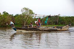 Family In Dugout Canoe