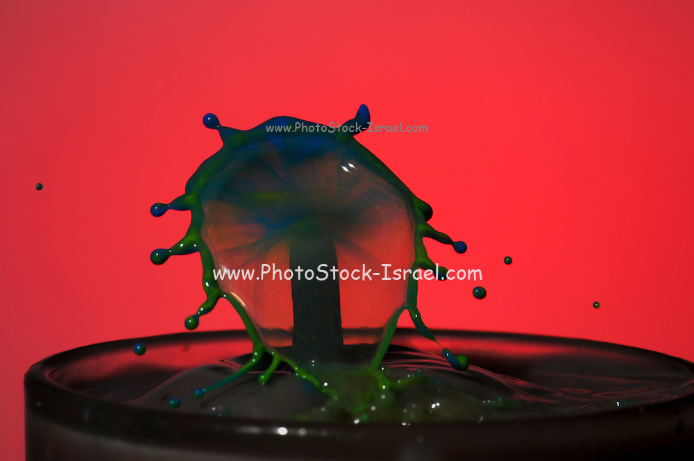 High-speed flash photograph liquid droplets. The droplet lands in the liquid and produces coronet.