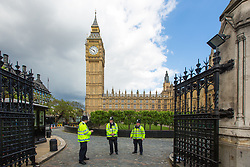 Big Ben and House of Commons with Bobby police officers, England, UK. 12/05/14. Photo by Andrew Tallon