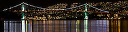 Panorama of the Lions Gate Bridge at night from Stanley Park, Vancouver, British Columbia..
