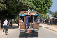 People packing into a Dale Dale, the local form of transportation.  Zanzibar, Tanzania