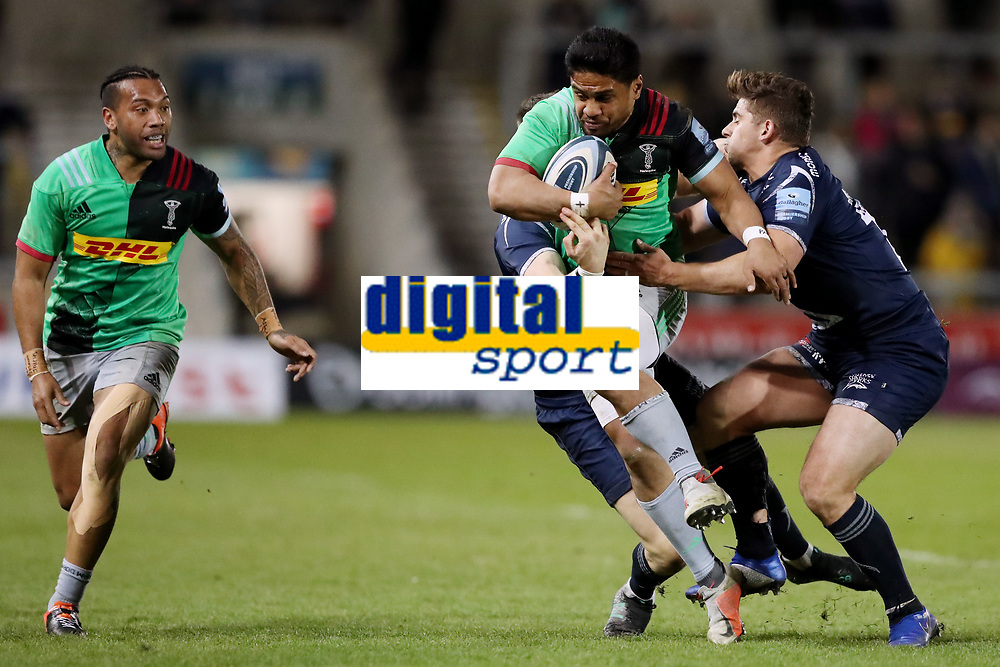 Rugby Union - 2018 / 2019 Gallagher Premiership - Sale Sharks vs. Harlequins<br /> <br /> Ben Tapuai of Harlequins is tackled by Sam James and Rohan Janse Van Rensburg of Sale Sharks, at the AJ Bell Stadium.<br /> <br /> COLORSPORT/PAUL GREENWOOD