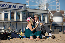 © Licensed to London News Pictures . 13/09/2019. Bournemouth, UK. A couple share ice creams and a kiss on Bournemouth Beach as a late summer heatwave brings high temperatures to the south coast of England . Photo credit: Joel Goodman/LNP