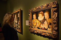 "© Licensed to London News Pictures. 09/10/2013. London, England. A museum worker stands in front of a painting depicting ""Three Unknown Elizabethan Children"" by an Unknown artist. Press preview of the exhibition ""Elizabeth I & Her People"" at the National Portrait Gallery which explores the remarkable reign of Elizabeth I through the lives and portraiture of her subjects. Exhibition runs from 10 October 2013 to 5 January 2014. Photo credit: Bettina Strenske/LNP"