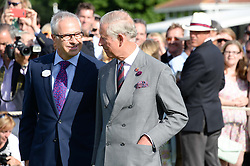 Left to right, JON ZAMMETT and HRH The PRINCE OF WALES at the Audi International Polo at Guards Polo Windsor Great Park, Egham, Surrey on 28th July 2013.