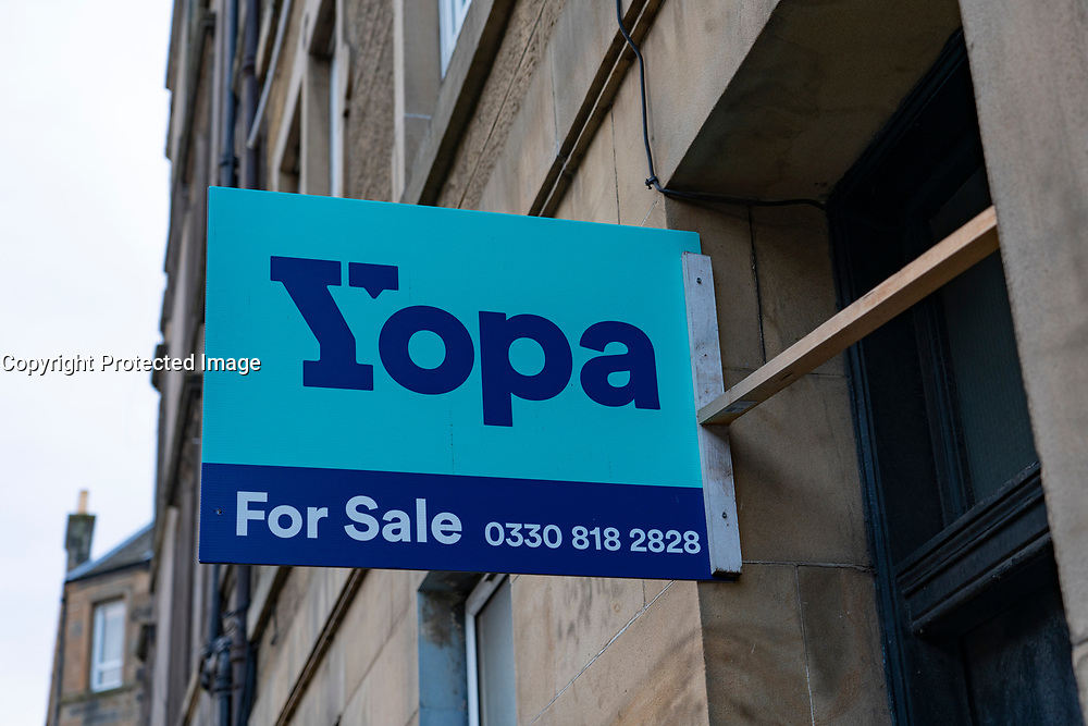 Yopa house for sale sign  sign outside tenement apartment block in Edinburgh Scotland, UK