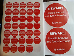 "© Licensed to London News Pictures . Collect photograph of a box of stickers of the type stuck to a display in Sainsbury's on Regent Road in Salford as today (23rd July 2015) Liam Edwards has been sentenced to a four-week curfew to run between 2100 and 0700 at Manchester Magistrates' Court. Edwards was charged with Causing Racially or Religiously Aggravated Criminal Damage . On 18th February 2015 , stickers reading "" Beware! Halal is barbaric and funds terrorism "" were placed by Edwards on products and displays in Sainsbury's supermarket , on Regent Road in Salford . Photo credit : LNP"