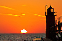 Beautiful sunset on the South Pier lighthouse on Lake Michigan in South Haven, Michigan.