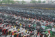 The largest bike cemetery outside Shanghai<br /><br />Bike sharing in China has multiplied over the years with various brands offering shared bikes which can be unlocked using an application on your mobile telephone, and then locked and left anywhere for the next rider. Ofo and Mobike are the two world leaders. One of the problems is the huge over supply of bikes, which has meant many startups going out of business, and huge bike cemeteries created on the outskirts of China's mega cities, where hundred's of thousands of bikes are rusting away.