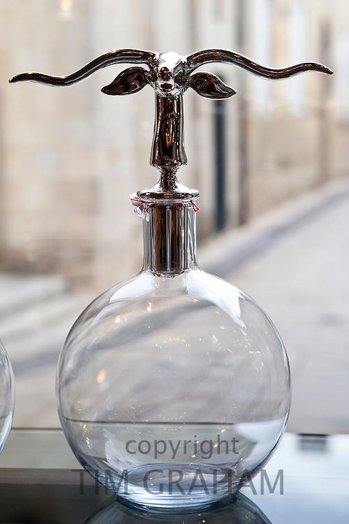 Ornate wine decanter in Vignobles et Chateaux wine merchants shop in St Emilion in the Bordeaux wine region of France