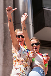 © Licensed to London News Pictures. 27/06/2015. Trafalgar Square, London, UK. Onlookers cheer as they watch participants take part in the annual Pride parade in London, one of the world's largest LGBT+ events.  Hundred of thousands of people gathered to watch the events on a hot summer's afternoon. Photo credit : Stephen Chung/LNP