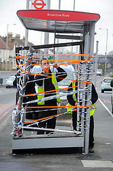 © Licensed to London News Pictures. 23/12/2013 London, UK. A bus stop is taped up at the scene of an accident  where three people died after a car collided with a lorry and caught fire. A Subaru Impreza was travelling on London's North Circular Road in Arnos Grove at about 00:30 GMT when it hit the central reservation.<br /> It then crashed into the lorry, which was coming in the other direction, and burst into flames. A second car, a Vauxhall Astra, was also involved in the crash. Two men in that car and the driver of the lorry <br /> Photo credit : Simon Jacobs/LNP