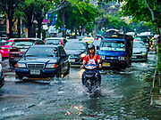 27 MAY 2017 - BANGKOK, THAILAND: A motorcyle taxi on Ekkamai Road, flooded by monsoonal rains, in suburban Bangkok. The rainy season in Bangkok usually starts in mid-June but started almost a month early this year. There have been daily thunderstorms and localized flooding throughout central Thailand since the middle of May.     PHOTO BY JACK KURTZ