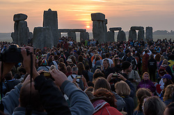 June 21, 2017 - Amesbury, Wiltshire, UK - Summer Solstice celebrations at Stonehenge. Shortly after sunrise on the longest day of the year. (Credit Image: © Simon Chapman/London News Pictures via ZUMA Wire)