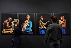 London, UK.  17 May 2017.  Visitors view works by Awol Erizku.  Preview of Photo London 2017 at Somerset House.  Held for the third time, the event showcases the best in contemporary photography, from 89 galleries from 16 different countries, for collectors and enthusiasts and will be on from 18 - 21 May. Credit: Stephen Chung / Alamy Live News