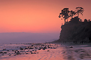 People walking on sand at Butterfly Beach at sunset, Santa Barbara, California