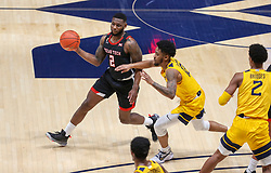 Jan 25, 2021; Morgantown, West Virginia, USA; Texas Tech Red Raiders guard Jamarius Burton (2) passes the ball while defended by West Virginia Mountaineers guard Taz Sherman (12) during the first half at WVU Coliseum. Mandatory Credit: Ben Queen-USA TODAY Sports