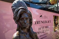 © Licensed to London News Pictures. 23/07/2021. LONDON, UK.  The statue of Amy Winehouse by sculptor Scott Eaton stands in Stables Market in Camden Town on the tenth anniversary of the late singer's death.  Photo credit: Stephen Chung/LNP