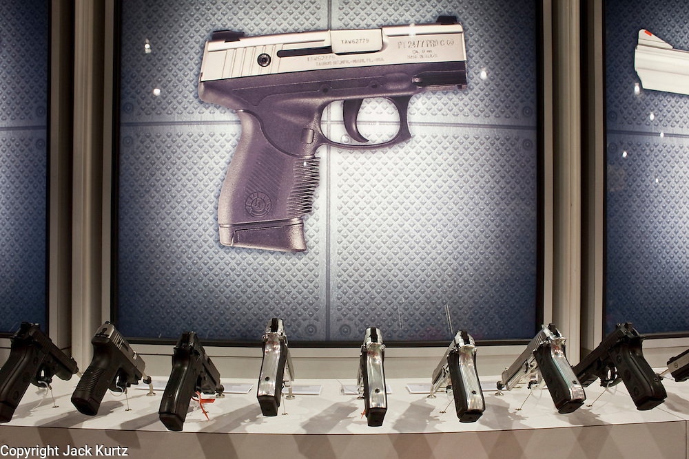 16 MAY 2009 -- PHOENIX, AZ: Handguns on display at the Taurus booth at the convention in Phoenix, AZ, Saturday. About 60,000 people were expected to attend the trade show at the 138th annual National Rifle Association Annual Meeting in the Phoenix Convention Center in Phoenix, AZ. Photo by Jack Kurtz