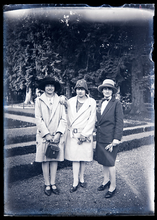 fashionable dressed woman only group posing in a garden France circa 1920s