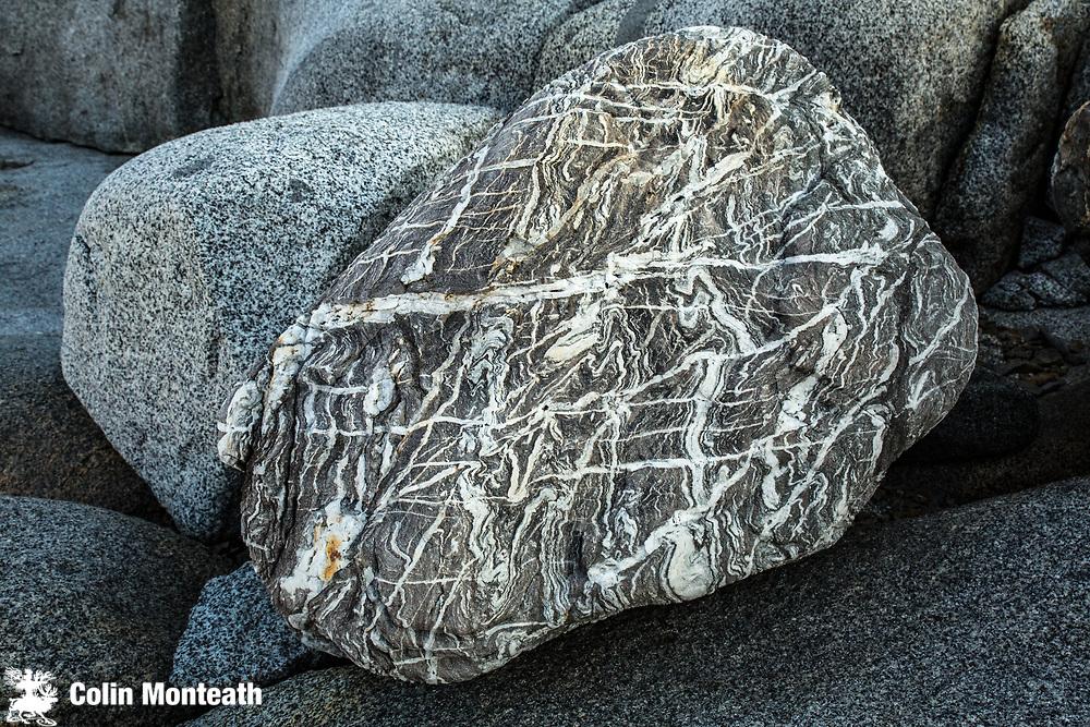 Quartz boulder, Granite slabs, Hoovgard Is. Antarctica