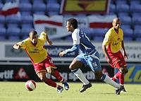 Photo: Andi Thompson.<br />Wigan Athletic v Watford. The Barclays Premiership. 23/09/2006.<br />Wigan's Antonio Valencia (centre) runs at the Watford defence