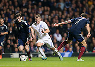 Scotland's Andrew Robertson tussles with England's Jack Wilshere<br /> <br /> - International Friendly - Scotland vs England- Celtic Park - Glasgow - Scotland - 18th November 2014  - Picture David Klein/Sportimage