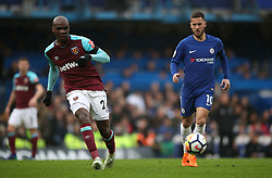 West Ham United's Angelo Ogbonna (left) and Chelsea's Eden Hazard during the Premier League match at Stamford Bridge, London.