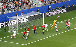 Spain goalkeeper Sandra Panos (centre right) makes a save under pressure