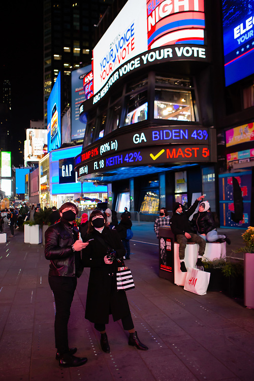 New York, NY - 3 November 2020. New York City anticipates presidential election results as polls in some states close. The ABC News studio in Times Square announces preliminary election results as crowds arrive.