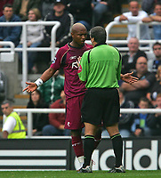 Photo: Andrew Unwin.<br /> Newcastle United v Bolton Wanderers. The Barclays Premiership. 15/10/2006.<br /> Bolton's El-Hadji Diouf (L) argues with the referee, Alan Wiley (R).