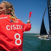Leg 3, Cape Town to Melbourne, day 01 Leg start on board MAPFRE.Sophie Ciszek holds up a penalty flag during the race start. Photo by Jen Edney/Volvo Ocean Race. 10 December, 2017.