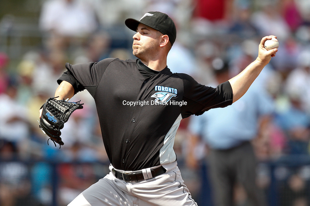 March 8, 2011; Port Charlotte, FL, USA; Toronto Blue Jays starting pitcher Marc Rzepczynski (34) during a spring training exhibition game against the Tampa Bay Rays at Charlotte Sports Park.   Mandatory Credit: Derick E. Hingle