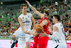 Ole Wendt of Germany passes Daniel Theis of Germany during basketball match between National teams of Serbia and Latvia in Quarterfinal Match of U20 Men European Championship Slovenia 2012, on July 20, 2012 in SRC Stozice, Ljubljana, Slovenia. (Photo by Matic Klansek Velej / Sportida.com)