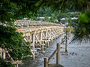 The Togetsu-kyo Bridge has been a landmark in Western Kyoto's Arashiyama District for over four hundred years. It spans the Katsura River and it is also called the Moon Crossing Bridge
