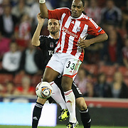 Besiktas's Tomas SIVOK (L) and Stoke's Cameron JEROME (R) during their UEFA Europa League Group E soccer match Besiktas between Stoke at Stoke Stadium in Stoke-on-Trent City England on Thursday September 29, 2011. Photo by TURKPIX