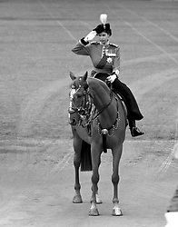 File photo dated 7/6/1951 of Princess Elizabeth, in her uniform as Colonel of the Grenadiers, salutes as she returns to Buckingham Palace from the Trooping the Colour ceremony on Horse Guards Parade. The military parade has marked the official birthday of the sovereign for more than 270 years.