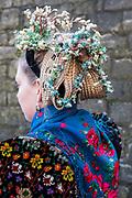 Sophia of the Volkstrachtenverein Ochsenfurt e.V.  is wearing an original traditional costume in Ochsenfurt, Lower Franconia, Germany on February 18, 2018.<br /> <br /> The original bridal dress is from around 1920, the bridal crown from around 1935 and the bridal bouquet from 1935. Sophia is wearing Biedermeier Jewelry.