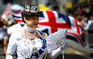 A woman dressed as the queen smiles as she attends the annual Gay Pride parade in London, Britain, 29 June 2013. BOGDAN MARAN / BPA