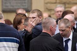 © Licensed to London News Pictures . 30/08/2012 . Manchester, UK . The funeral of Winnie Johnson . Alan Bennett gestures towards the press pen . Moors Murderer Ian Brady and Myra Hindley murdered Johnson 's 12 year old son Keith Bennett . Winnie Johnson dedicated her life to finding her son's body . Photo credit : Joel Goodman/LNP