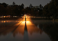 Middletown, New York - Fog on a lake is lit by light from a street light on June 14, 2011.