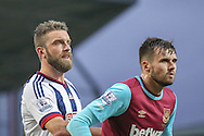 West Bromwich Albion forward Rickie Lambert  and West Ham United defender, on loan from Arsenal, Carl Jenkinson  during the Barclays Premier League match between West Ham United and West Bromwich Albion at the Boleyn Ground, London, England on 29 November 2015. Photo by Simon Davies.