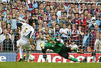 Photo: Chris Ratcliffe.<br />Liverpool v West Ham United. The FA Cup Final. 13/05/2006.<br />Anton Ferdinand of West Ham misses as Jose Reina of Liverpool saves.