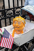 A mock pram and fake Donald Trump head during a demonstration against U.S. President Donald Trumps state visit to the U.K on the 4th June 2019 in London in the United Kingdom. Day two of President Trumps three-day state visit, which includes lunch with the Queen, a State Banquet at Buckingham Palace as well as business meetings with the Prime Minister and the Duke of York, before travelling to Portsmouth to mark the 75th anniversary of the D-Day landings.