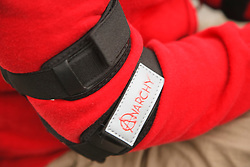 Girl wearing elbow pad for skateboarding or cycling