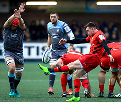 Ben Spencer of Saracens kicks despite the attentions of Seb Davies of Cardiff Blues<br /> <br /> Photographer Simon King/Replay Images<br /> <br /> European Rugby Champions Cup Round 4 - Cardiff Blues v Saracens - Saturday 15th December 2018 - Cardiff Arms Park - Cardiff<br /> <br /> World Copyright © Replay Images . All rights reserved. info@replayimages.co.uk - http://replayimages.co.uk