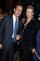 ALASTAIR TEDFORD and JOANNA JOHNSTON at a party hosted by Tanner Krolle held at Leighton House, 12 Holland Park Road, London W14 on 8th December 2005.<br />