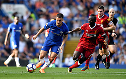 Chelsea's Eden Hazard (centre) and Liverpool's Sadio Mane battle for the ball during the Premier League match at Stamford Bridge, London.